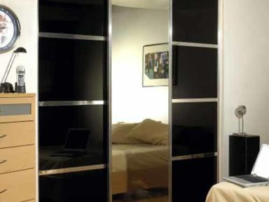sliding wardrobe mirror and wood