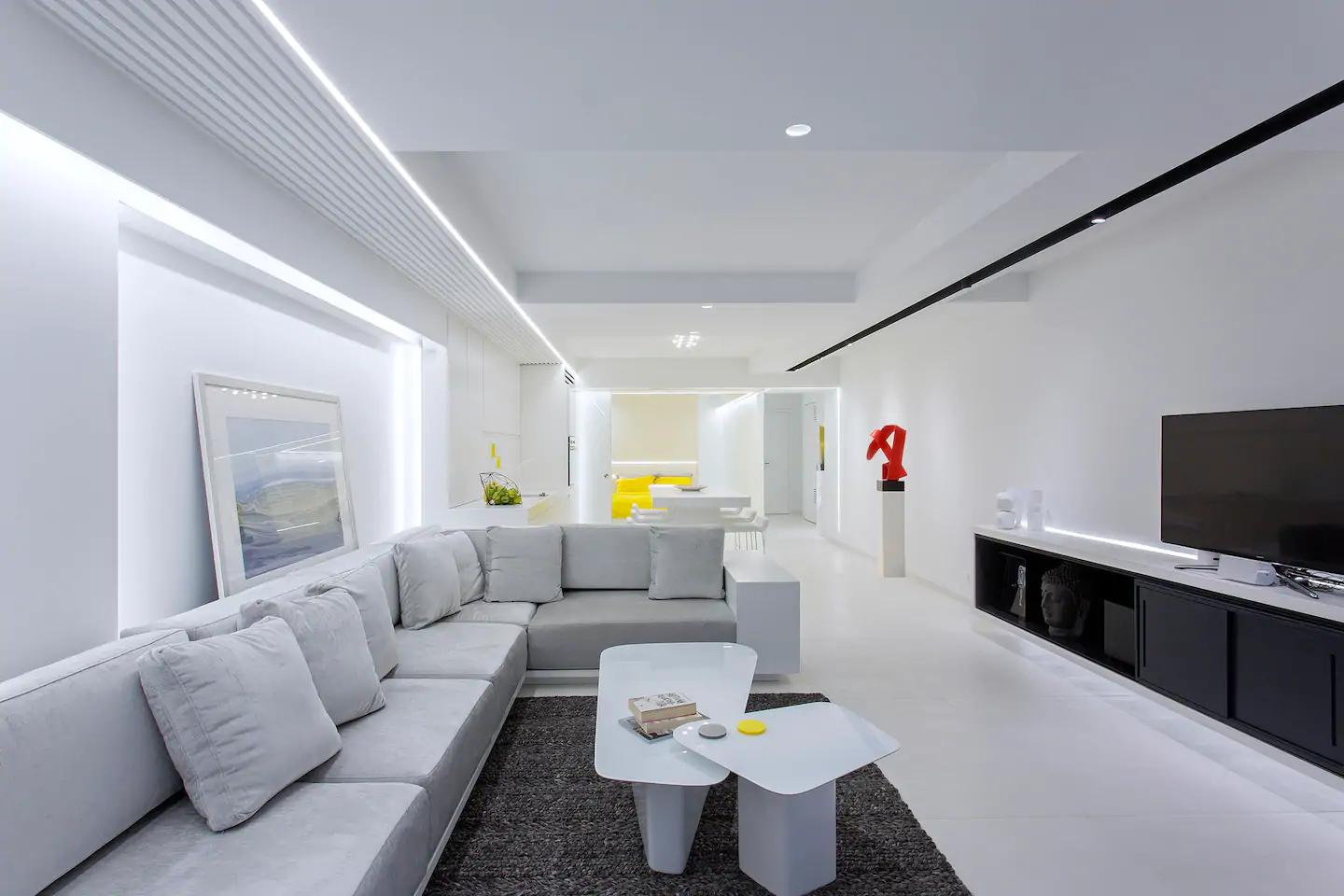 White living room with volumetric designs